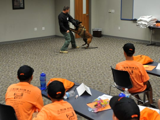 Wichita Falls Police Officer John Ricketts and Canine Officer Turko demonstrate to a group of junior high kids the force a police dog can provide while trying to bring a fleeing suspect to a stop during a previous Junior Citizen's Police Academy.