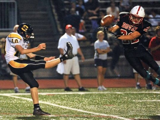 Dover's Logan Ambrose (right) blocks a punt during the Eagles' 52-14 win over Solanco last Friday.