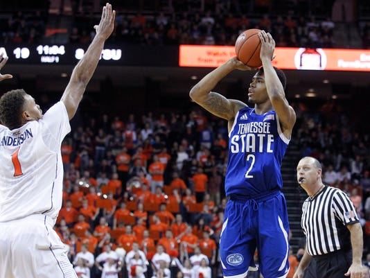 Tennessee State guard Marcus Roper (2) takes a shot over Virginia guard Justin Anderson (1) during the first half of an NCAA basketball game at John Paul Jones Arena in Charlottesville, Va. on Tuesday, Nov 25, 2014. (AP Photo/Ryan M. Kelly)