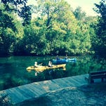 Kayakers on the Estero River near Koreshan State Historic Site, one of several local parks that have out-of-date management plans that will not be updated for at least a year.l