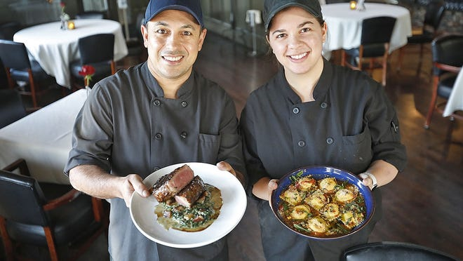 Sous chefs Davino Costa and Carolina Mantovani show off a couple of signature dishes at Tosca in Hingham on Sunday, Oct. 11.  Greg Derr/ The Patriot Ledger
