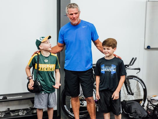 Brett Favre meets with a couple of kids last year at