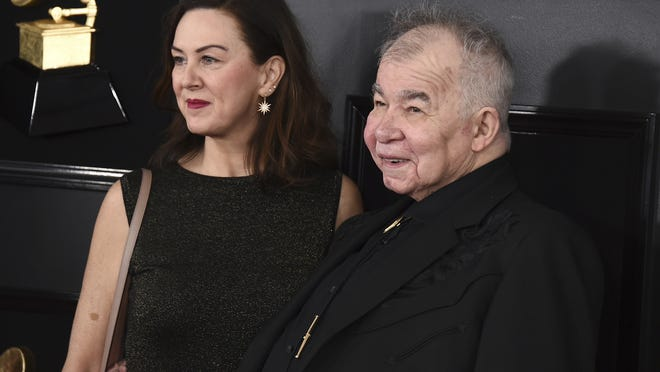 Fiona Whelan Prine, left, and John Prine in 2019. The wife of the late celebrated singer-songwriter John Prine, who died from complications of COVID-19, is urging lawmakers to expand absentee voting so Tennesseans would not have to put their health at risk exercising their right to vote.