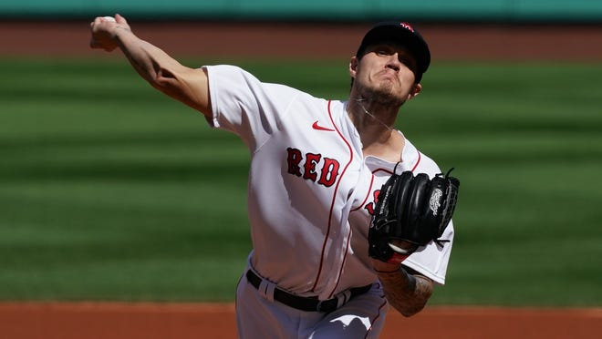 Red Sox starting pitcher Tanner Houck delivers against the Yankees in the first inning on Sunday.