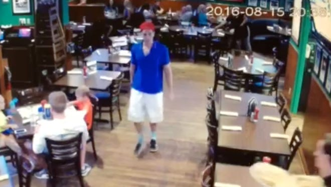 This image made from a video released Friday, Aug. 19, 2016, by Duffy's Sports Grill, shows Austin Harrouff leaving the restaurant in Jupiter, Fla. A Florida sheriff's said Friday that Harrouff caught trying to bite the face off a victim after stabbing the man and wife, will be charged with first-degree murder. (Duffy's Sports Grill via AP)