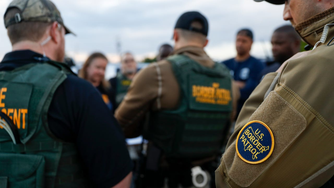 U.S. Immigration and Customs Enforcement released video of agents arresting more than 100 workers at a meatpacking plant in Salem, Ohio on Tuesday. The workers are accused of immigration violations. (June 20)