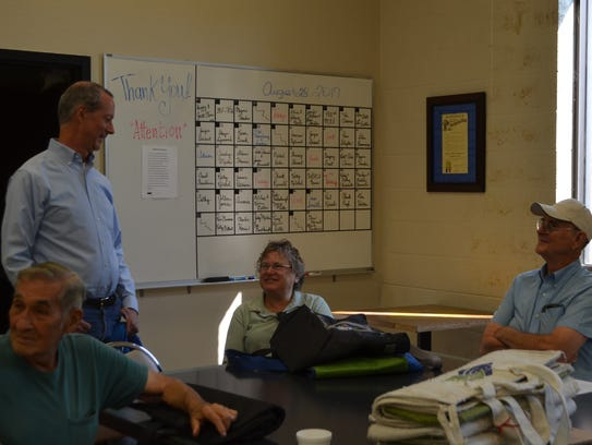 U.S. Rep. Mac Thornberry, left, visits with Meals on