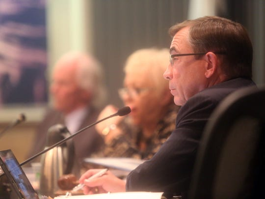 Palm Springs Mayor Robert Moon listens to a resident who speaks in support  of a gun control ordinance during a city council meeting of Palm Springs on September 7, 2017.