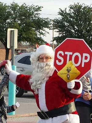 The Big Man in Red stopped traffic on Dec. 11 at the Early Childhood Education Center.