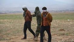 Two Islamic State fighters captured near Sinjar, Iraq.