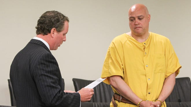 Freehold,  NJ       (L)  Marc LeMieux 1st assistant prosecutor for Monmouth County reads the charges against  Philipe Seidle, a Neptune police officer charged with the murder of his wife Tamara in Asbury Park.  Seidle, while off duty, shot his wife multiple times killing her.   061715 Photo: Tom Spader/staff
