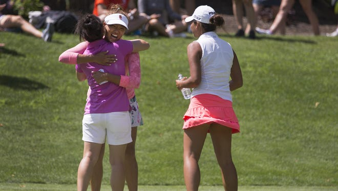 Annie Park gets a hug from Jennifer Yang after winning the Symetra Tour's Toyota Danielle Downey Classic at Brook-Lea Country Club on July 19, 2015.