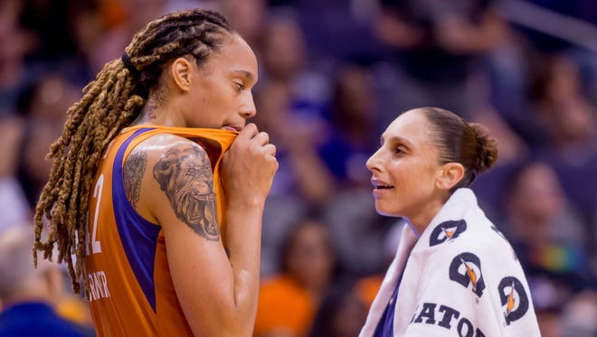 Phoenix Mercury center Brittney Griner listens to Phoenix Mercury guard Diana Taurasi during a time out on July 21, 2018, during the Phoenix Mercury's match up against the Minnesota Lynx at Talking Stick Arena in Phoenix, Arizona.
