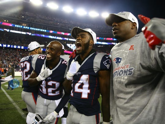 Jan 21, 2018; Foxborough, MA, USA; New England Patriots players including Devin McCourty (32) and Brandin Cooks (14) celebrate after defeating the Jacksonville Jaguars in the AFC Championship Game at Gillette Stadium.
