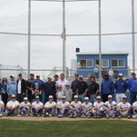 Poudre's current baseball team, front, and alumni during a celebration of the 50th anniversary of baseball at Poudre.