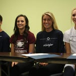 From left, Resurrection Christian's Koby Bishop, Madison Webb, Hailey Lemos and Preston Lienemann at their National Letter of Intent signing.