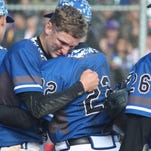 Resurrection Christian's Luke Fick is consoled after the Cougars lost 12-10 to Rye in the Class 2A baseball championship game.