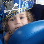 Piper Christian, 4, loved the hats handed out on the San Diego Seal Tour.
