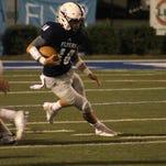 Loyola's Carter Windham runs against the Sterlington defense on Friday night at Messmer Stadium.