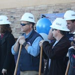 Liberty Common coaches and administration at the groundbreaking for a new high school gym on Tuesday.
