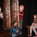 "D (played by Sean Cahill seated, center) is a lonely boy who finds solace in Greek mythology thanks to his friend Blue (Julia Mayhood, far right) in ""The Book of D."" The play receives its world premiere at The Growing Stage - The Children's Theatre of New Jersey in Netcong starting today."