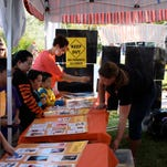 Kids and families play games at the 2013 Spooky Town Fair, organized by the Washington County School District Foundation to raise money for classrooms.