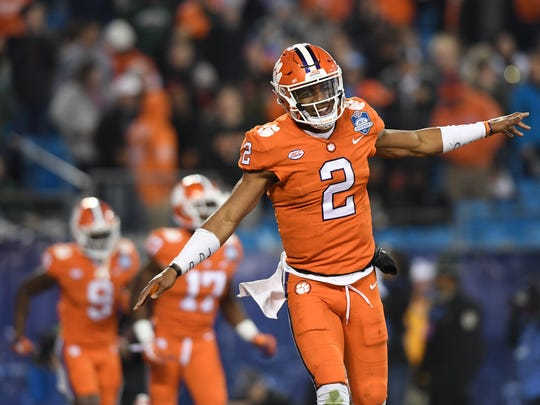 Clemson quarterback Kelly Bryant (2) reacts after throwing a TD to wide receiver Deon Cain (8) against Miami during the 3rd quarter of the ACC championship game against Miami at Bank of America Stadium in Charlotte on Saturday, December 2, 2017.