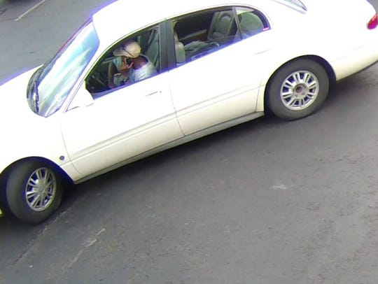 The robbery suspect is shown leaving in a white car.