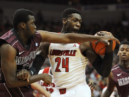 UofL's Montrezl Harrell (24) battles for a loose ball against Missouri State's Emmanuel Addo (left) on Tuesday at the KFC Yum! Center. Dec. 17, 2013
