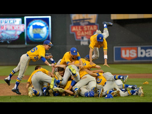 St. Cloud Cathedral players pile on pitcher Dominic Austing as they celebrate their 5-4 State Class 2A Championship victory over Fairmont Monday afternoon, June 16 at Target Field in Minneapolis.