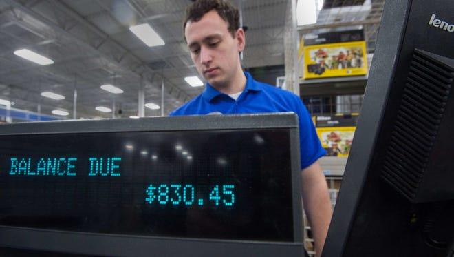 Salesperson rings at Best Buy, Fairfax, Va., Nov. 27, 2014.