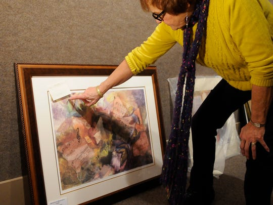 """Theresa Balboa talks about her piece, """"Harmony or Musician's Trash,"""" Tuesday morning in the museum."""
