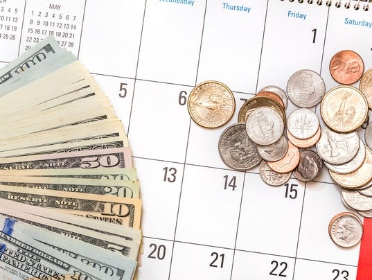 American banknotes and american coins on the calendar