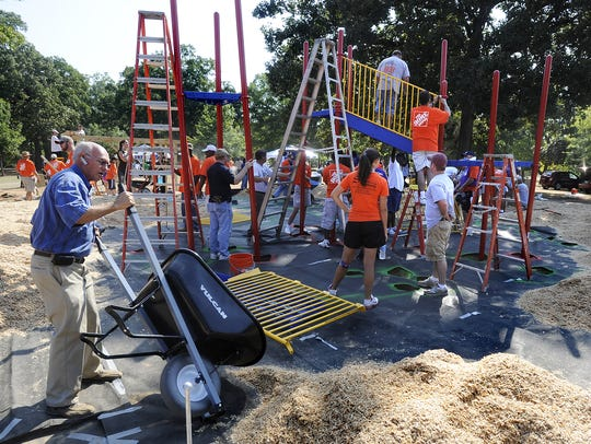 Hundreds of volunteers build a playground at Oak Park