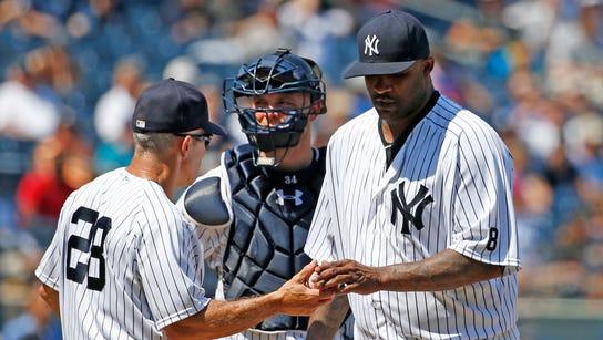 New York Yankees manager Joe Girardi (28) takes the