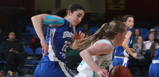 Dobbs Ferry's Molly Althoz chases Irvington's Lindsay Halpin during their Class B girls basketball semifinal at the Westchester County Center Feb. 25, 2014.