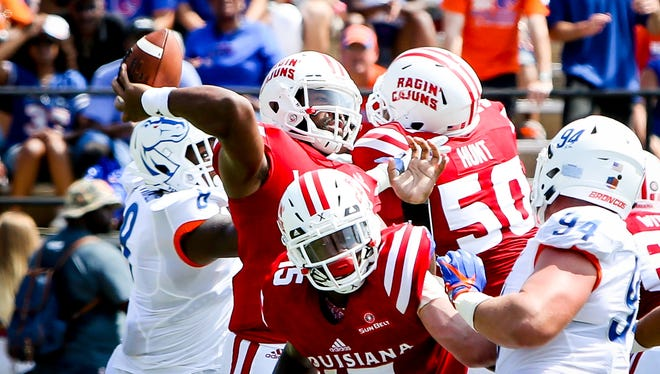 UL quarterback Anthony Jennings throws from the pocket while facing heavy pressure in Saturday's loss to Boise State.
