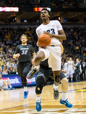 Marquette Jajuan Johnson gets fouled while driving to the basket against Creighton on Saturday at the BMO Harris Bradley Center.