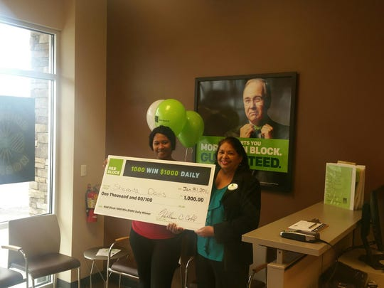 Shavonta Davis, left, won the H&R Block 1,000 Win $1,000 Daily Sweepstakes. Jean Conrad (H&R Block Tax Professional) joins in on the festivities.