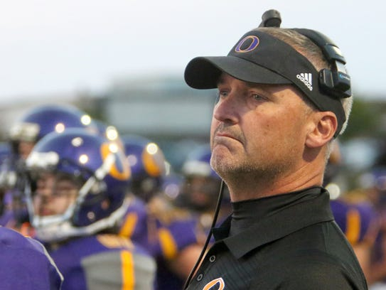 Oconomowoc Head Coach Greg Malling at home against