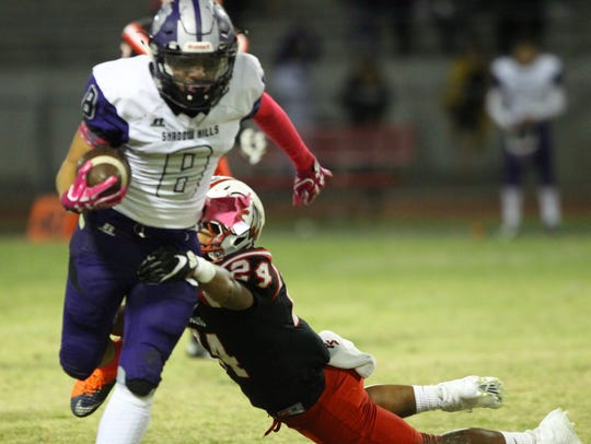 Shadow Hills High School's Kaleb Welmas runs for yardage