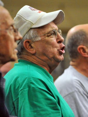 Tommy Clark sings with the rest of the members of the Lancaster Men's Chorus during rehearsal March 30 at St. Peter Lutheran Church in Lancaster.