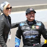IndyCar Series driver Alex Tagliani poses for a photo with his wife Bronte Tagliani after qualifying for the 2014 Indianapolis 500 at the Indianapolis Motor Speedway.