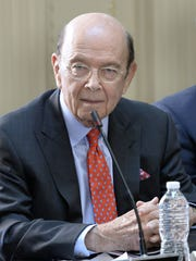 Commerce Secretary Wilbur Ross listens as President