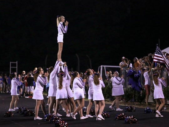 Cheerleaders rally the crowd and the team during the