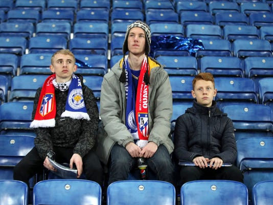 Leicester City fans sit in the stadium after the second leg of the UEFA Champions League quarter final soccer match between Leicester City and Atletico Madrid at the King Power Stadium in Leicester, Tuesday April 18, 2017. The match ended a 1-1 draw with Atletico advancing to the semifinals 2-1 on aggregate. (Nick Potts/PA via AP)
