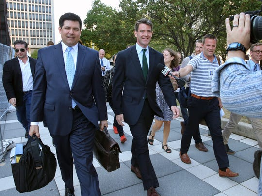 Bill Baroni, center, Gov. Chris Christie's former top appointee at the Port Authority of New York and New Jersey, and his attorney Michael Baldassare, center left, leave Federal Court after a hearing for jury selection Tuesday.