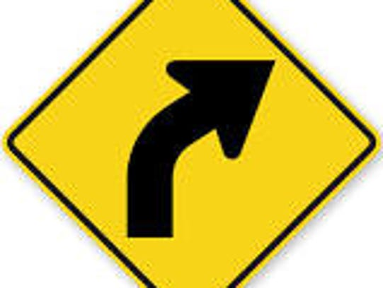 Curve warning signs