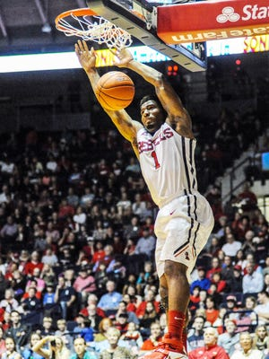 Ole Miss' Martavious Newby dunks against Troy in the Rebels' 83-80 overtime win on Tuesday at Tad Smith Coliseum in Oxford.