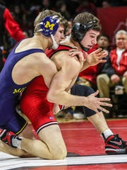 Rutgers' Anthony Ashnault (right) wrestles Michigan's Zac Hall at 141 pounds at the Louis Brown Athletic Center in Piscataway on Sunday.